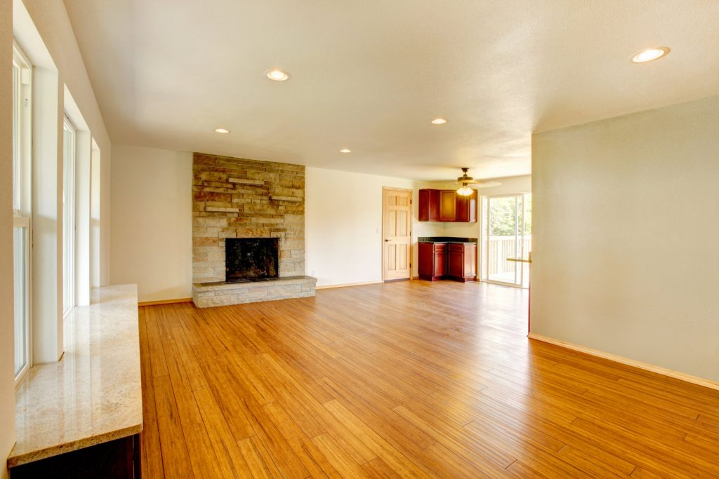 an empty living room with fireplace