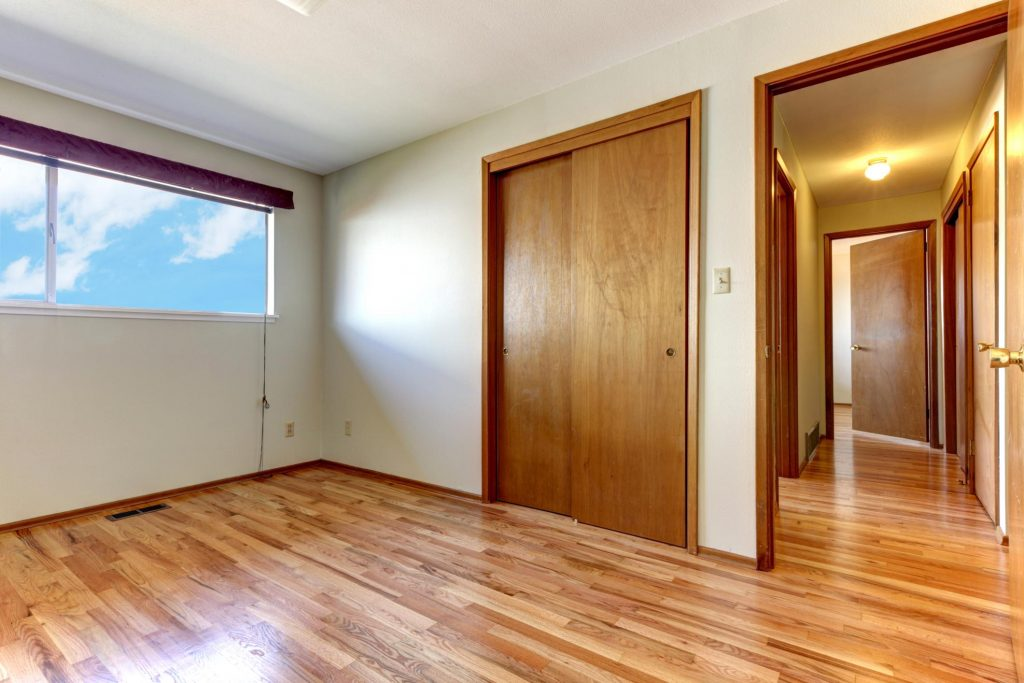 a newly built room with wood flooring